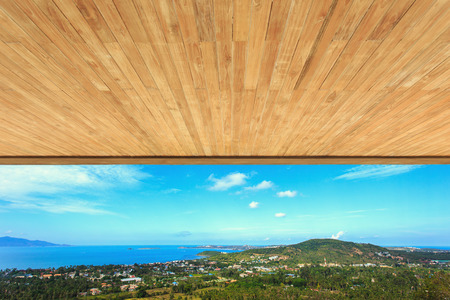 Wood ceiling texture with view to mountain photo
