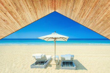 Wood ceiling with sunbed at the beach photo