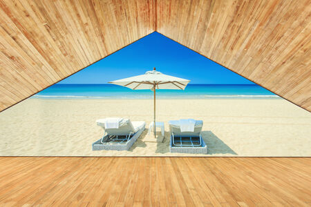 Wood ceiling with decking and sunbed at the beach photo