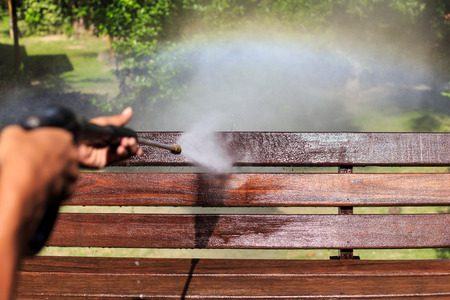 washer: Wooden cleaning with high pressure water jet Stock Photo