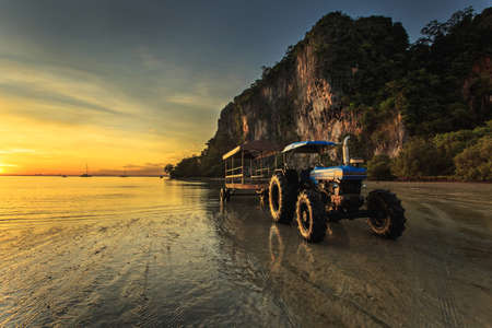 Tractor with trailer stand on the beach photo