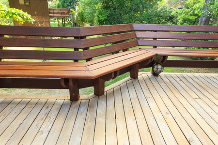 timber bench seat: Wooden bench Stock Photo