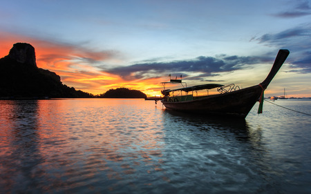 Traditional Thai boat, Long tail stand in the sea at Sunrise beach, Krabi, Thailand Stock Photo