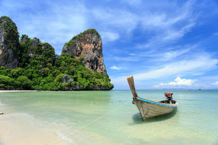 Traditional Thai boat, Long tail stand in the sea at Railay beach, Krabi, Thailand photo