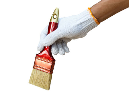 staining: hand holding brush and paint timber