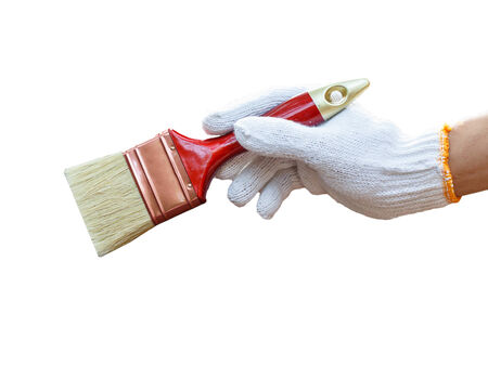 hand holding brush and paint timber