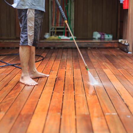 pressure washing: Thai man do a pressure washing on timber
