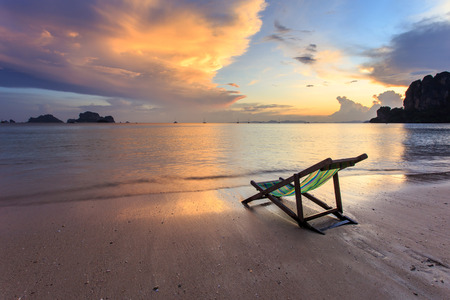 sun loungers stand on the sunset beach Stock Photo