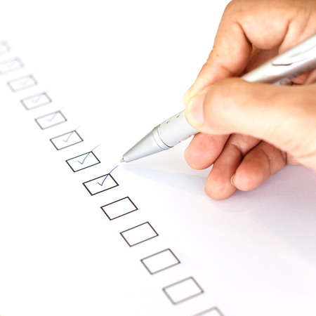 Hand writing on blank checkbox photo