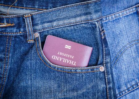 Close up of Passport in denim jeans pocket photo