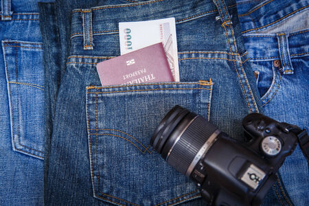 Close up Passport in denim jeans pocket photo