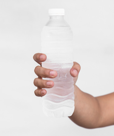 Close up of Woman hand holding bottle of drinking water