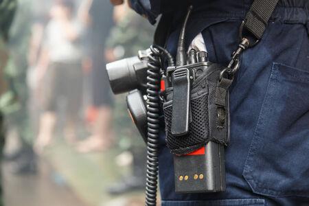 walkie talkie: Man using walkie talkie