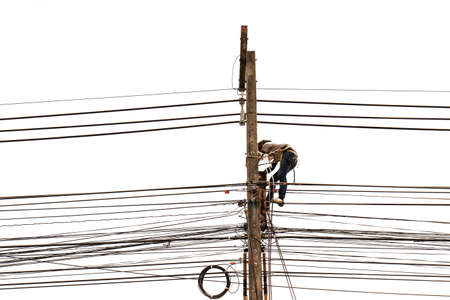 Man working on electric pole isolated on white background photo
