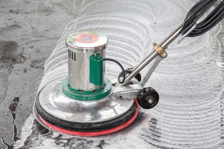 Thai people cleaning black granite floor with machine and chemical Archivio Fotografico