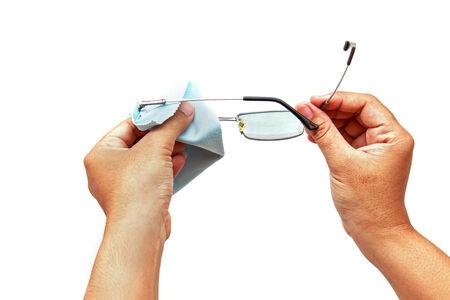 Hand holding glasses and black case isolated on white background photo