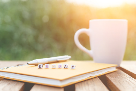 Sunday written in letter beads and a coffee cup on table Zdjęcie Seryjne - 33251691