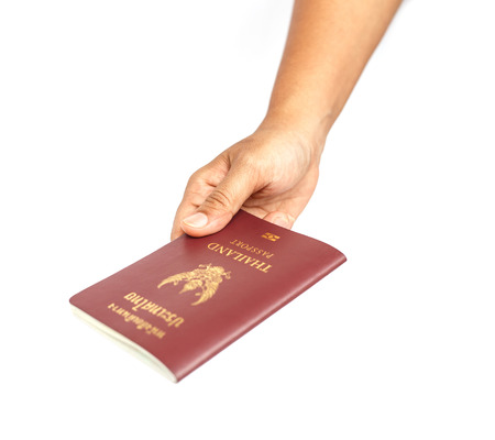 Hand holding Thailand passport isolated on white background photo