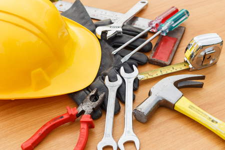 diy home repair: Closeup of assorted work tools on wood
