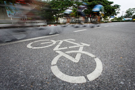 Bicycle sign or icon and movement of cyclist in the park photo