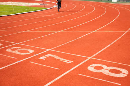 Running track numbers with runner. photo
