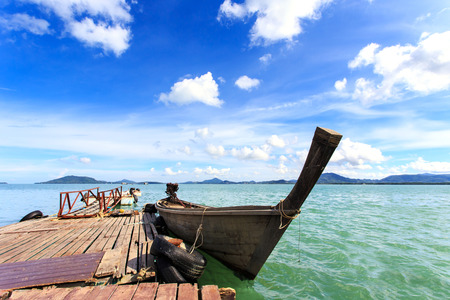 Traditional Thai boat, Long tail stand in the sea at Phuket, Thailand photo