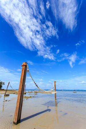 hammock between on tropical beach in Koh Samui photo