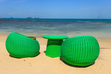beack: Modern seats stand on the beack, tropical sea and blue sky in Koh Samui, Thailand
