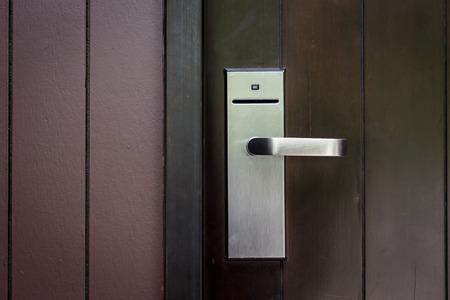 keycard: Entrance door with electronic keycard lock system