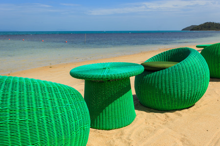 Modern seats stand on the beack, tropical sea and blue sky in Koh Samui, Thailand photo