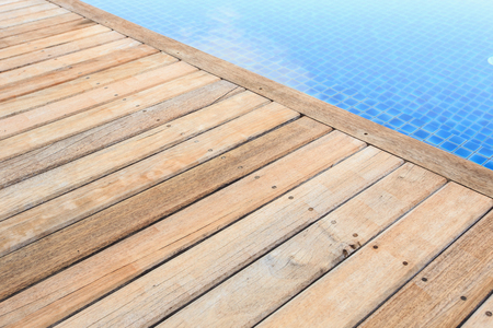 Wooden flooring beside the pool photo