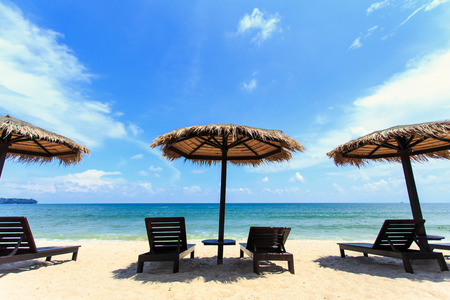 loungers: Sun umbrella and sun loungers stand at the beach in Phuket, Thailand