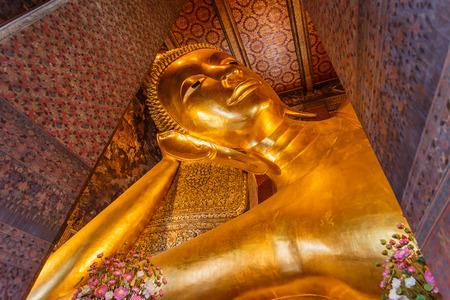 big buddha: Reclining Buddha gold statue face. Wat Pho, Bangkok, Thailand