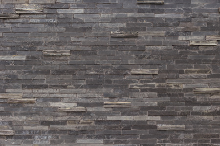 cladding tile: Black slate wall texture  and background