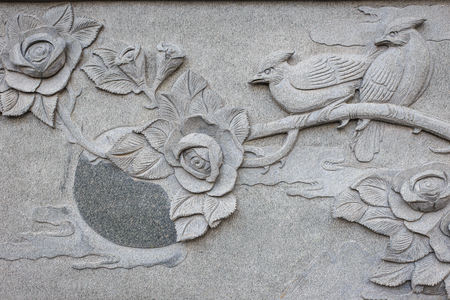 Close up granite carving in chinese temple photo