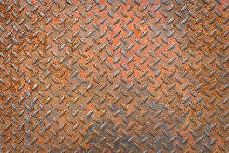 Background of metal diamond plate in red color with rusty photo
