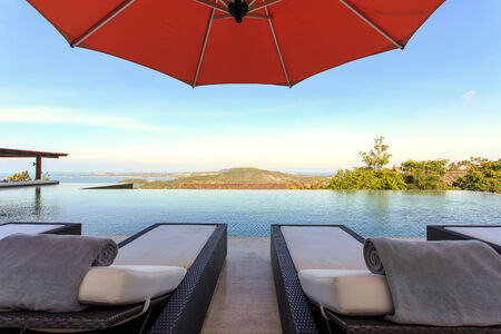 loungers: sun loungers stand at the pool and beautiful view