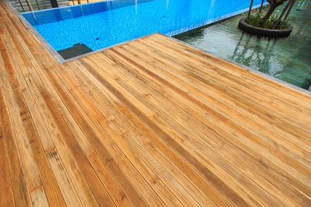 decking: Timber decking at surrounding the pool Stock Photo