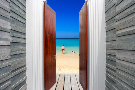 view of a wooden doorway: The open door to the Beach.