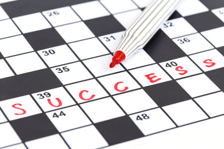 Close up red marker on Crossword - Success photo