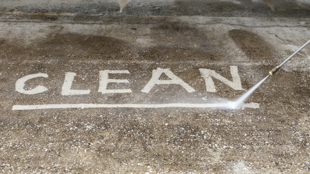 Outdoor floor cleaning with high pressure water jet Reklamní fotografie - 34107889