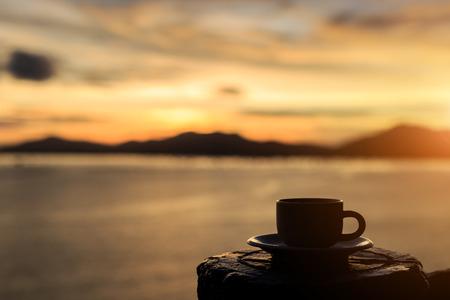 コーヒー カップと日没 写真素材