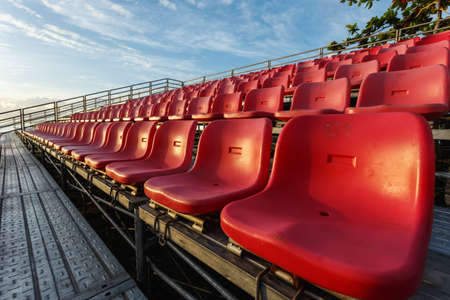 public sector: Empty plastic chairs at temporary grandstand stadium in Phuket, Thailand