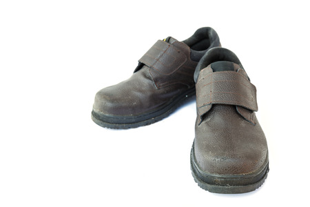 safety shoes: Old safety shoes isolated on white background