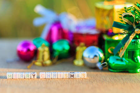Merry Chrismas written in letter beads and Christmas decorations photo