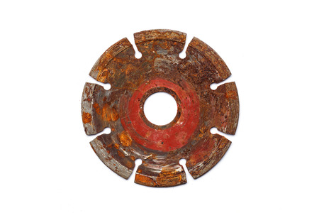Close up old Rotating metal blade of circular saw for stone