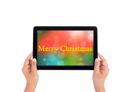Hand holding tablet with text merry christmas photo