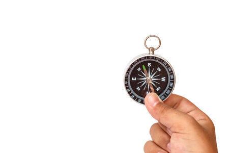 Hand holding Compass isolated on white background photo