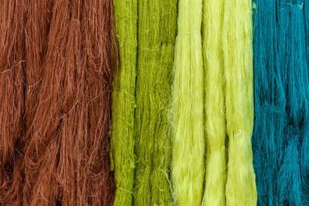 Raw silk thread for background. Stock Photo