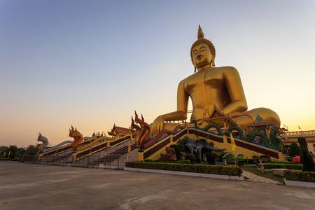 Big golden buddha statue in Thailand photo